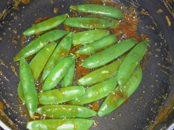 Add snap peas and stir until coated with sauce and just warmed through.