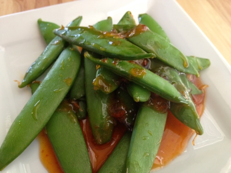 These sweet and spicy snap peas are ready in minutes and make a perfect side dish or healthy snack.