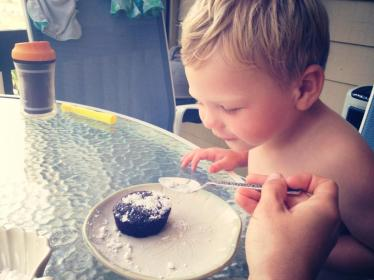 Who needs candles when you can blow powdered sugar on the cake.